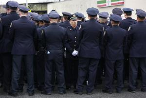NYPD officers (most of them) turning their backs on the mayor at a police funeral.